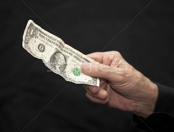 One Dollar in old hand. Including clipping path. Stock photo © sqback