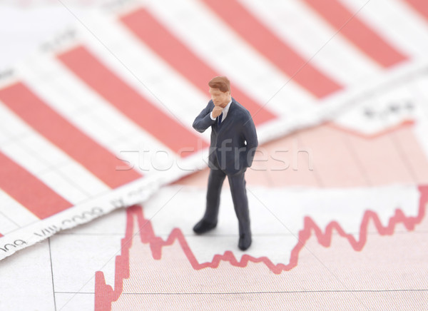 Crisis financiera figura empresario financieros gráficos periódico Foto stock © sqback