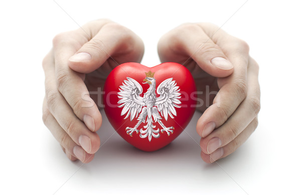 Hands covering Polish coat of arms on a red heart Stock photo © sqback