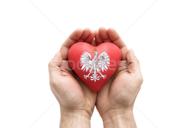 Hands covering Polish coat of arms on a red heart isolated on white background. Clipping path includ Stock photo © sqback