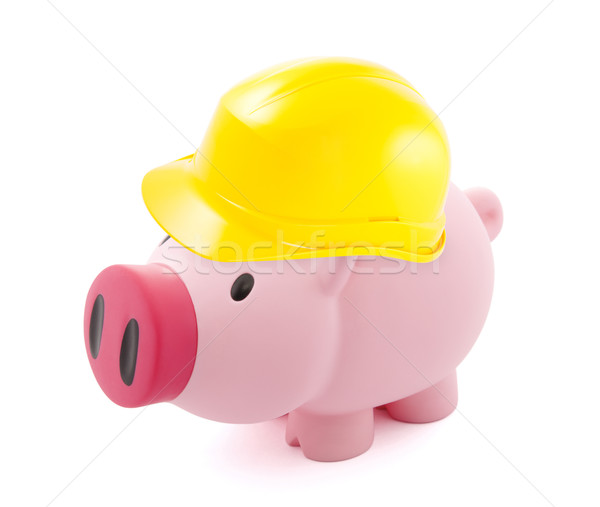 Piggy bank protected with hard hat Stock photo © sqback