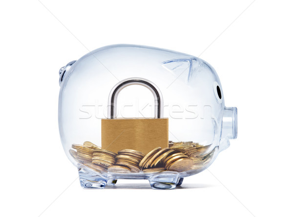 Padlock on money inside transparent piggy bank with clipping path  Stock photo © sqback