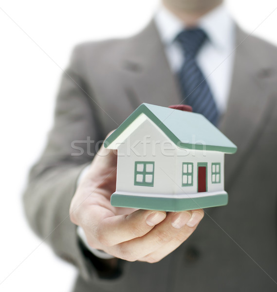 Real estate agent holding a toy house Stock photo © sqback