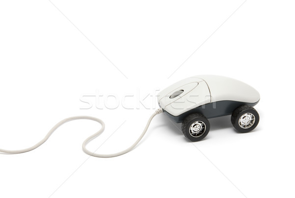 Stock photo: Computer mouse with wheels isolated on white with clipping path