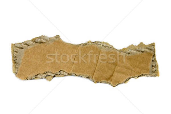Stock photo: Torn piece of cardboard isolated on white