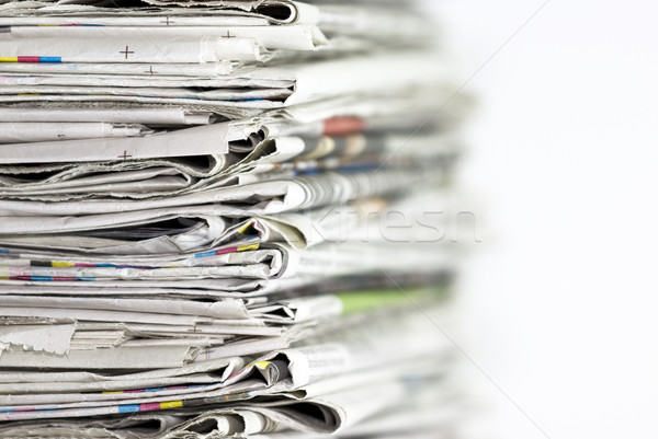 Pile of newspapers on white background Stock photo © sqback