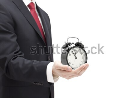 Businessman with an alarm clock in a hand isolated on white. Stock photo © sqback