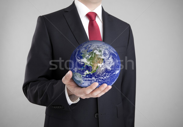 Businessman holding globe. Clipping path included. Earth image provided by Nasa.  Stock photo © sqback