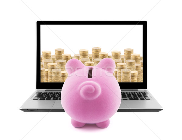Piggy bank and laptop with stacks of golden coins isolated on white  Stock photo © sqback