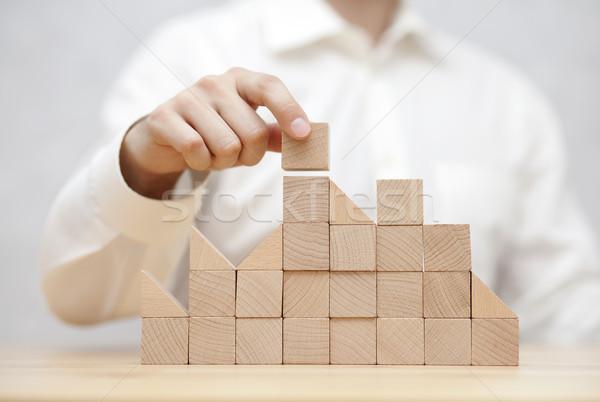 Man's hand stacking wooden blocks. Business development concept  Stock photo © sqback