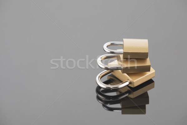Security concept with three metal padlocks  Stock photo © sqback