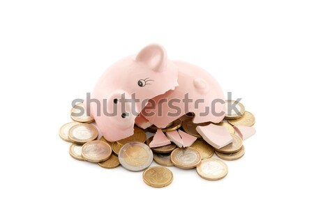 Broken piggy bank with coins on white background with clipping path  Stock photo © sqback