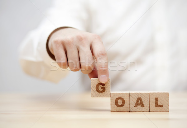 Hand and word Goal made with wooden building blocks  Stock photo © sqback