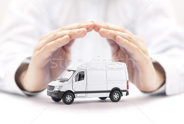 Transport white van car protected by hands  Stock photo © sqback
