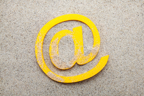 Yellow 3d email symbol in the sand Stock photo © sqback