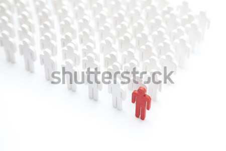 Stock photo: Group of people in the shape of a heart with one red person