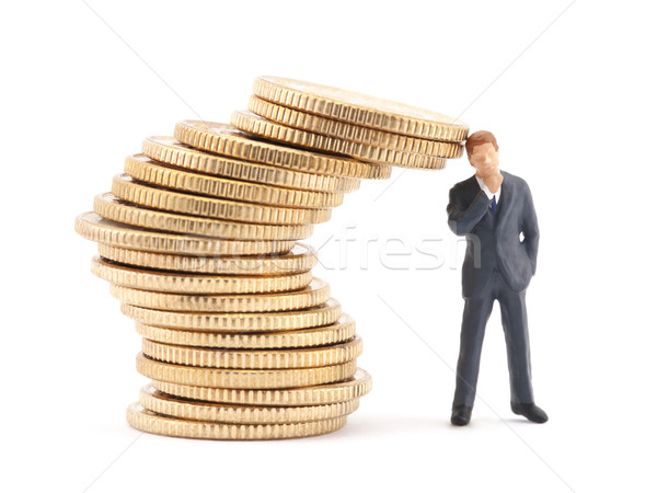 Figure of businessman and stack of coins Stock photo © sqback