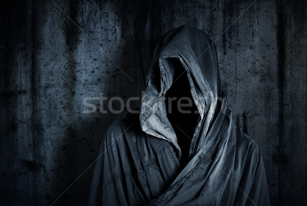 Stock photo: Ghostly figure in the dark