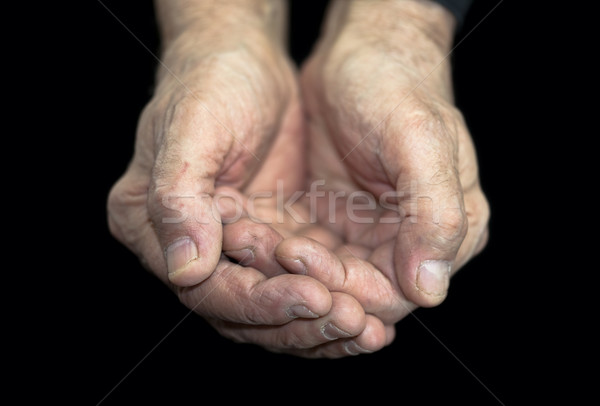 Poverty. Old hands on black with clipping path Stock photo © sqback
