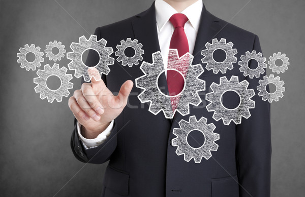 Businessman with gears, concept of well organized work process.  Stock photo © sqback