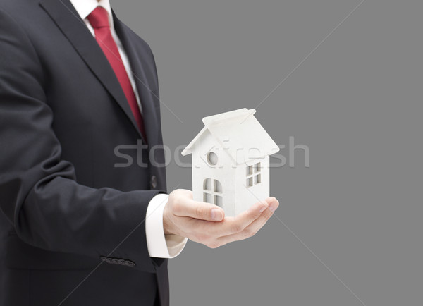 Businessman with white toy house miniature in hand Stock photo © sqback