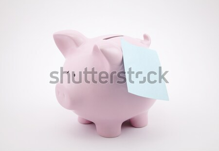 Pink piggy bank with IOU sticking out of its coin slot.  Stock photo © sqback