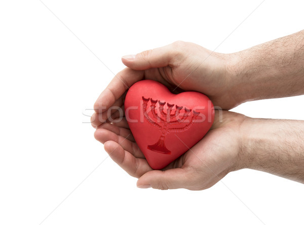 Red heart with imprinted menorah in man's hands.  Stock photo © sqback
