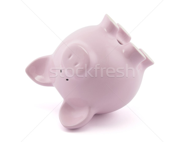 Pink piggy bank upside down. Clipping path included. Stock photo © sqback