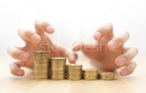 Greed for money. Hands grabbing coins.  Stock photo © sqback