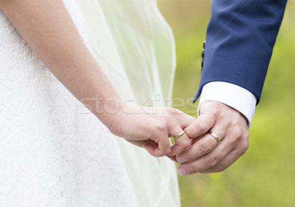 Esküvő pár kéz a kézben férfi öltöny menyasszony Stock fotó © sqback