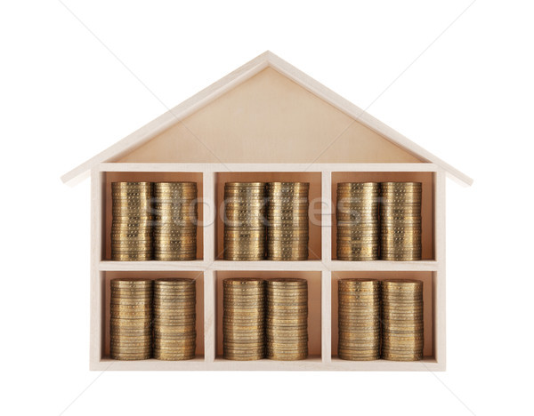 Wooden house with coins isolated on white  Stock photo © sqback
