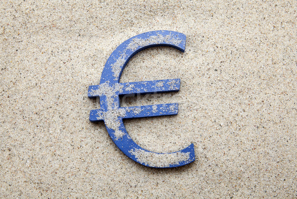 Blue euro symbol in the sand Stock photo © sqback