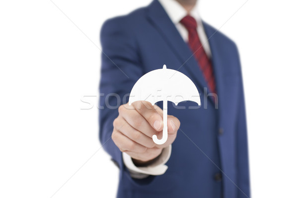 Businessman with umbrella shape isolated on white background. Clipping path included.  Stock photo © sqback