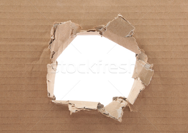 Ripped hole in cardboard on white background Stock photo © sqback