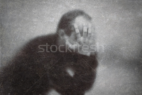 Depression. Broken man behind a dusty scratched glass.  Stock photo © sqback
