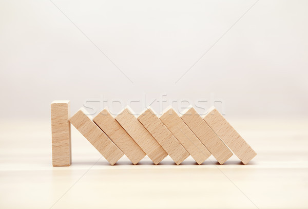 The domino effect stopped by a unique, one strong piece  Stock photo © sqback