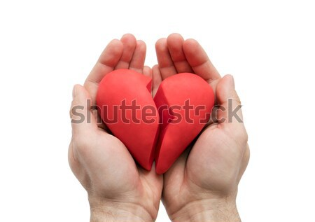Broken heart in hands isolated on white with clipping path  Stock photo © sqback