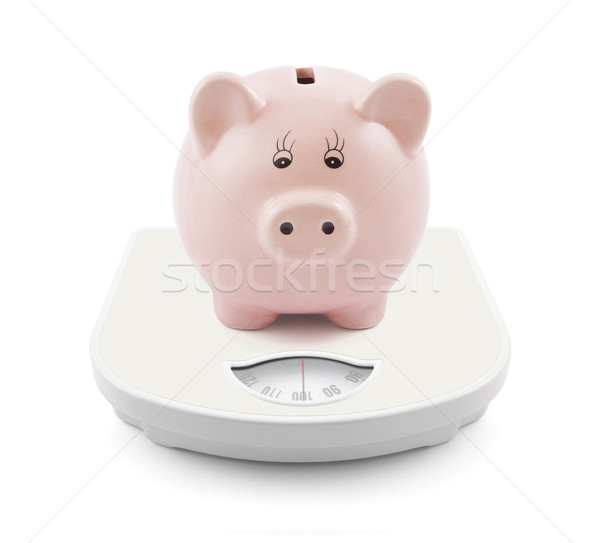 Piggy bank on scales Stock photo © sqback