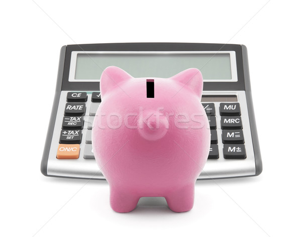 Piggy bank with callculator isolated on white  Stock photo © sqback