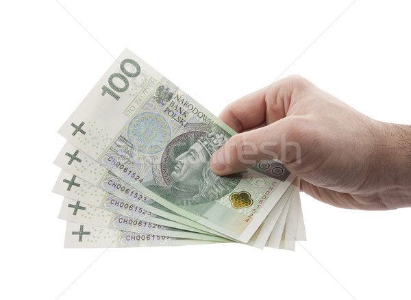 Stock photo: Polish money in hand with clipping path