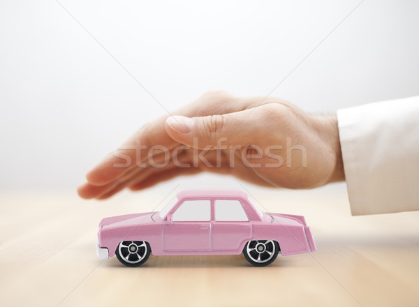 Classic old pink car toy covered by hand  Stock photo © sqback