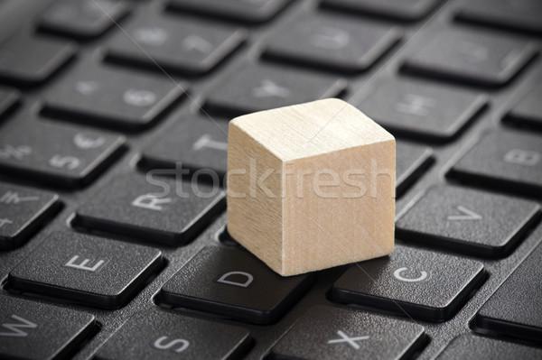Wooden block on laptop keyboard  Stock photo © sqback