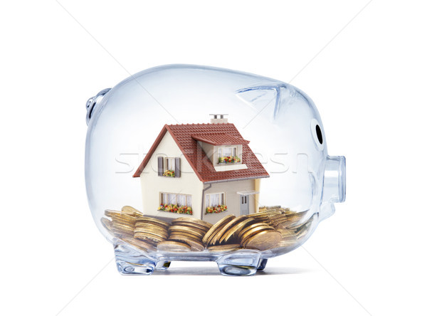 House on money inside transparent piggy bank with clipping path  Stock photo © sqback