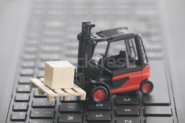 Forklift miniature with wooden block on laptop keyboard  Stock photo © sqback
