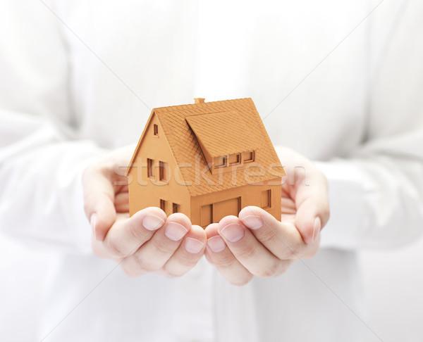 Küçük turuncu ev eller Bina ev Stok fotoğraf © sqback
