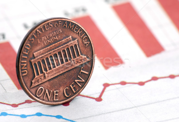 American one cent on newspaper chart Stock photo © sqback