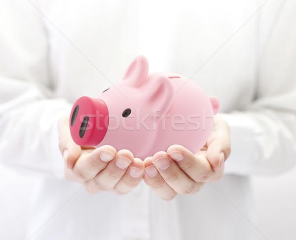 Man holding big pink piggy bank Stock photo © sqback