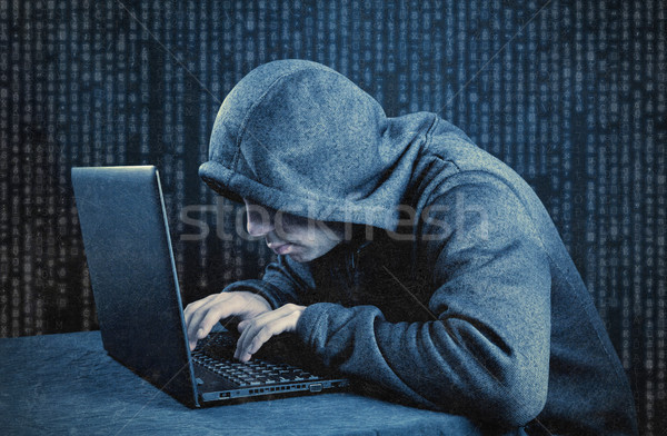 Hooded computer hacker with laptop  Stock photo © sqback