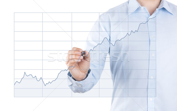Young man with growing chart  Stock photo © sqback