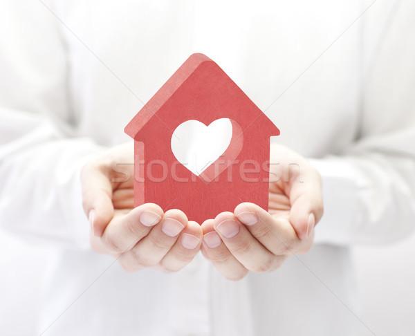 небольшой красный дома сердце рук здании Сток-фото © sqback